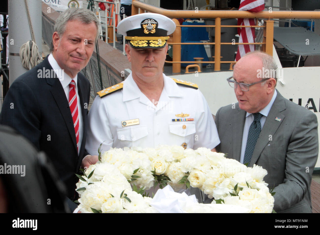 New York, NY, USA. 28th May, 2018. (L-R) New York City Mayor Bill De Blasio, Admiral Christopher Grady, United States Navy and Bruce Mosier, Co Chair, Intrepid Sear, Air & Space Museum attend the 2018 Memorial Day Ceremony held aboard the U.S.S Intrepid Sea, Air, Space Museum Complex on May 28, 2018 in New York City. Credit: Mpi43/Media Punch/Alamy Live News - Stock Image