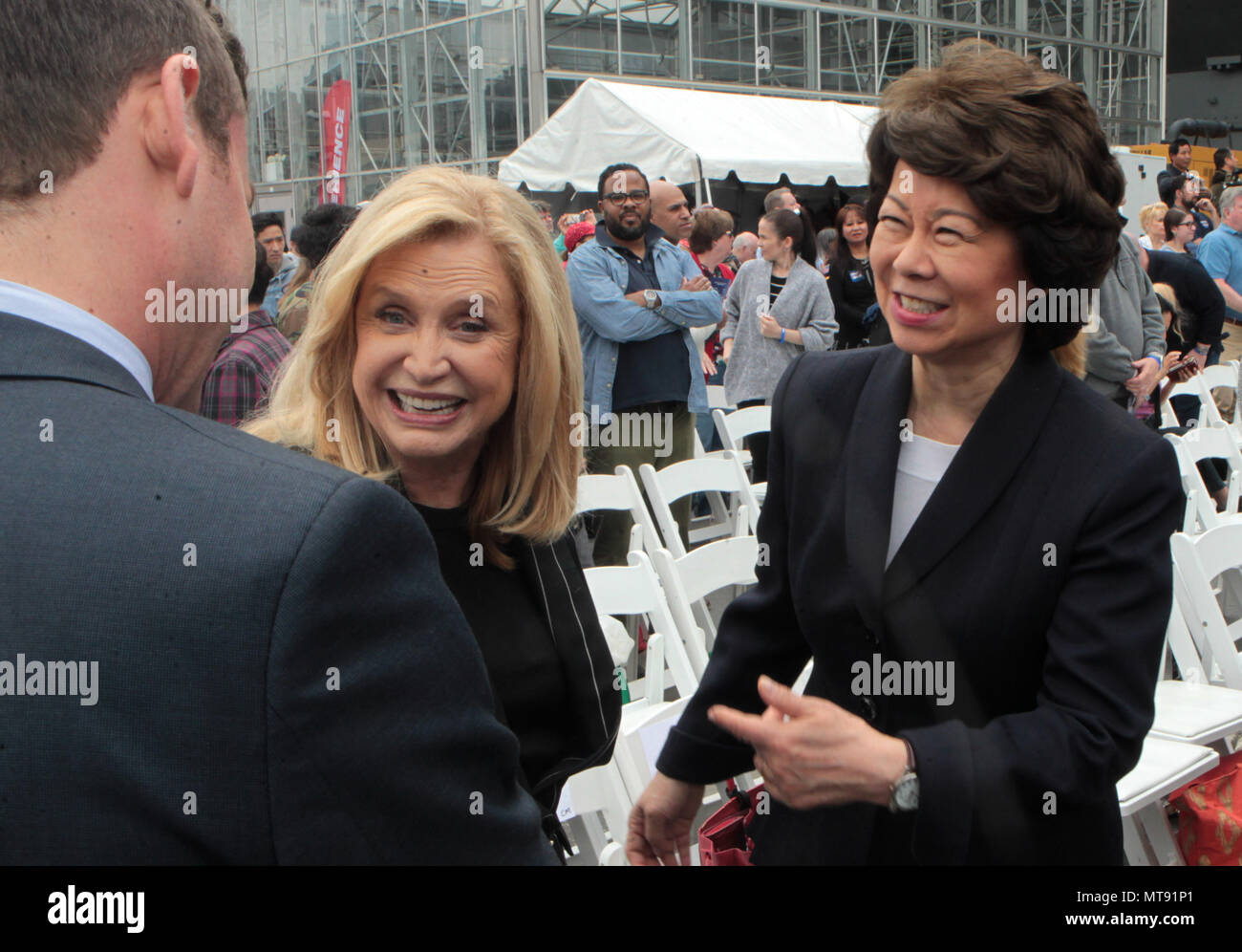 New York, NY, USA. 28th May, 2018. (L-R) Elaine Chao, U.S. Secretary of Transportation and Carolyn Maloney, U.S. Representative attend the 2018 Memorial Day Ceremony held aboard the U.S.S Intrepid Sea, Air, Space Museum Complex on May 28, 2018 in New York City. Credit: Mpi43/Media Punch/Alamy Live News - Stock Image