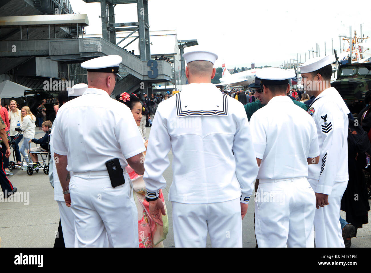 New York, NY, USA. 28th May, 2018. United States Navy Sailors attends the 2018 Memorial Day Ceremony held aboard the U.S.S Intrepid Sea, Air, Space Museum Complex on May 28, 2018 in New York City. Credit: Mpi43/Media Punch/Alamy Live News - Stock Image