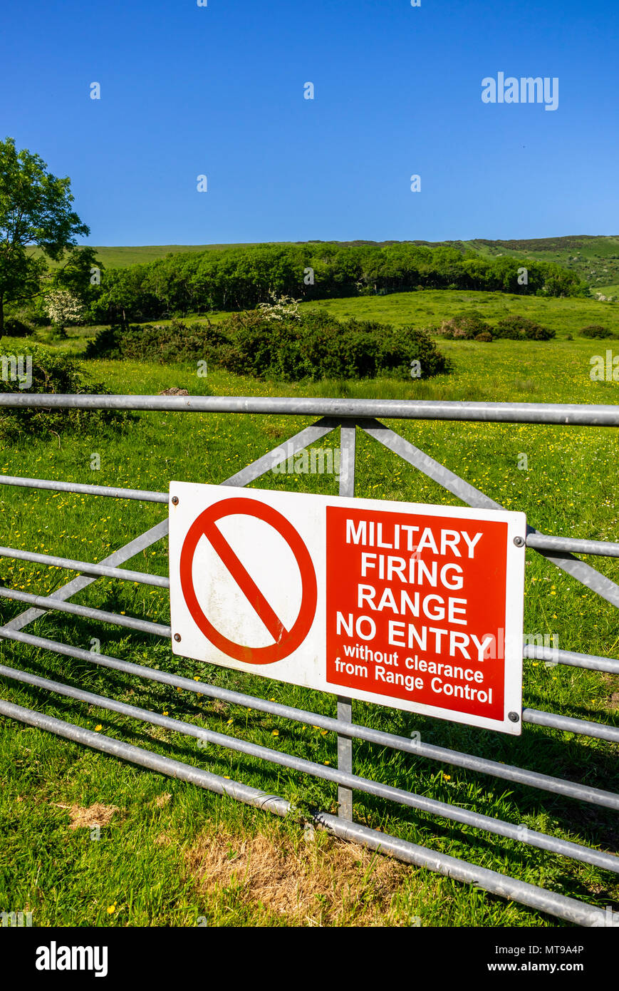 Red No Entry Sign outside the Lulworth Ranges, military firing ranges located between Wareham and Lulworth in Dorset, England, UK - Stock Image