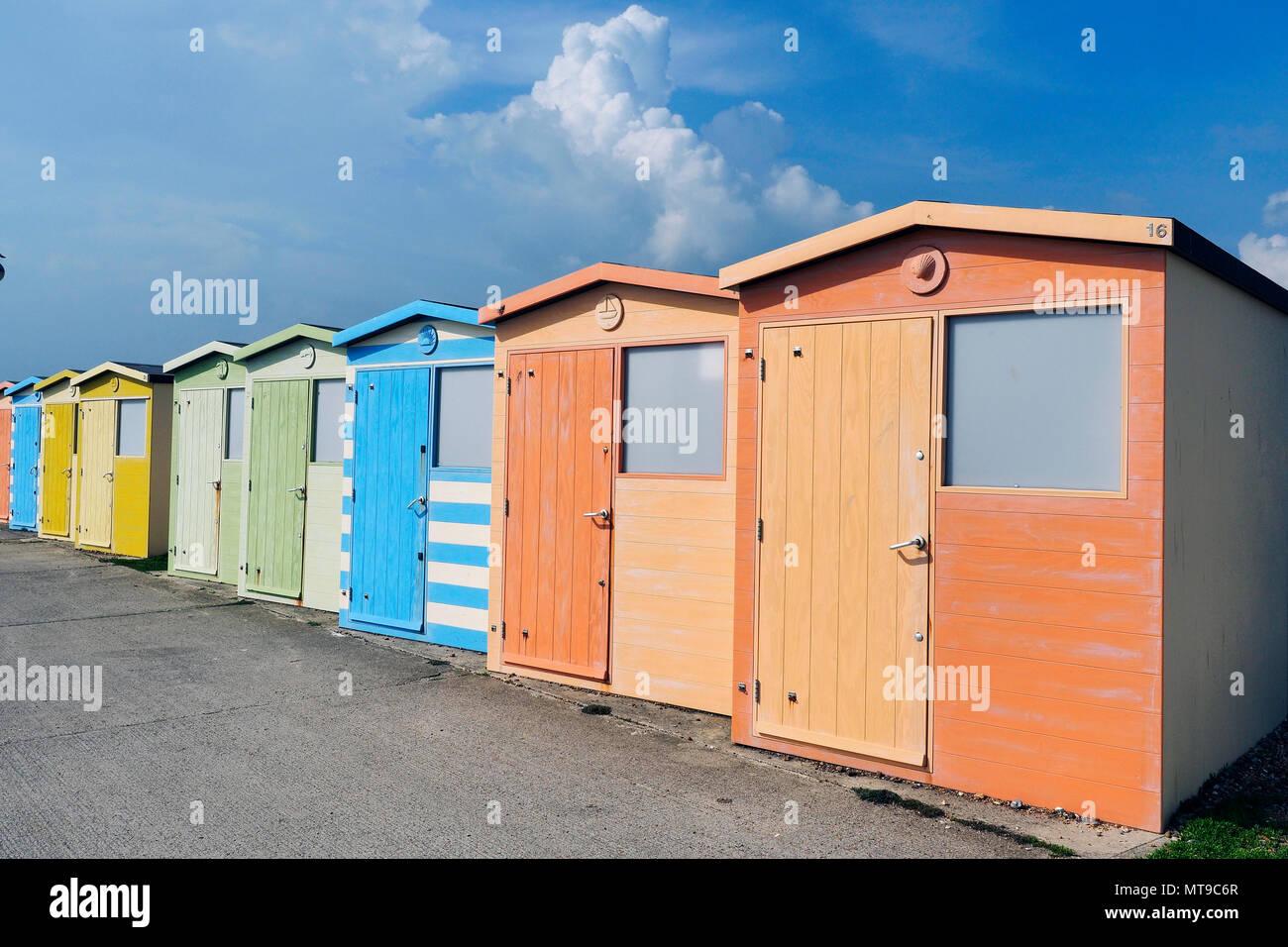 Beach huts on Seaford promenade - Stock Image