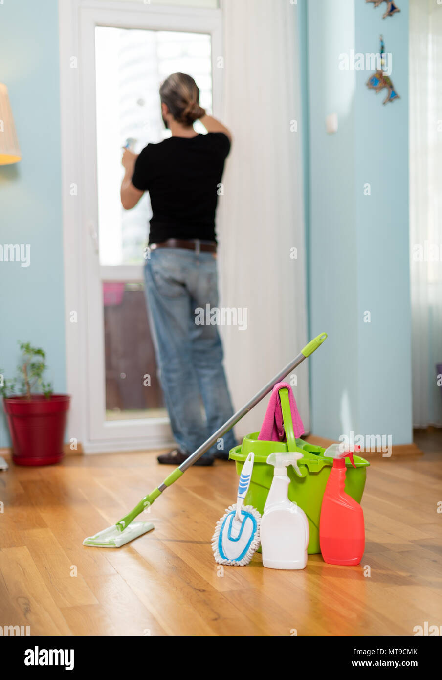 House cleaning, house cleaning man, house man sweeping and mopping - Stock Image