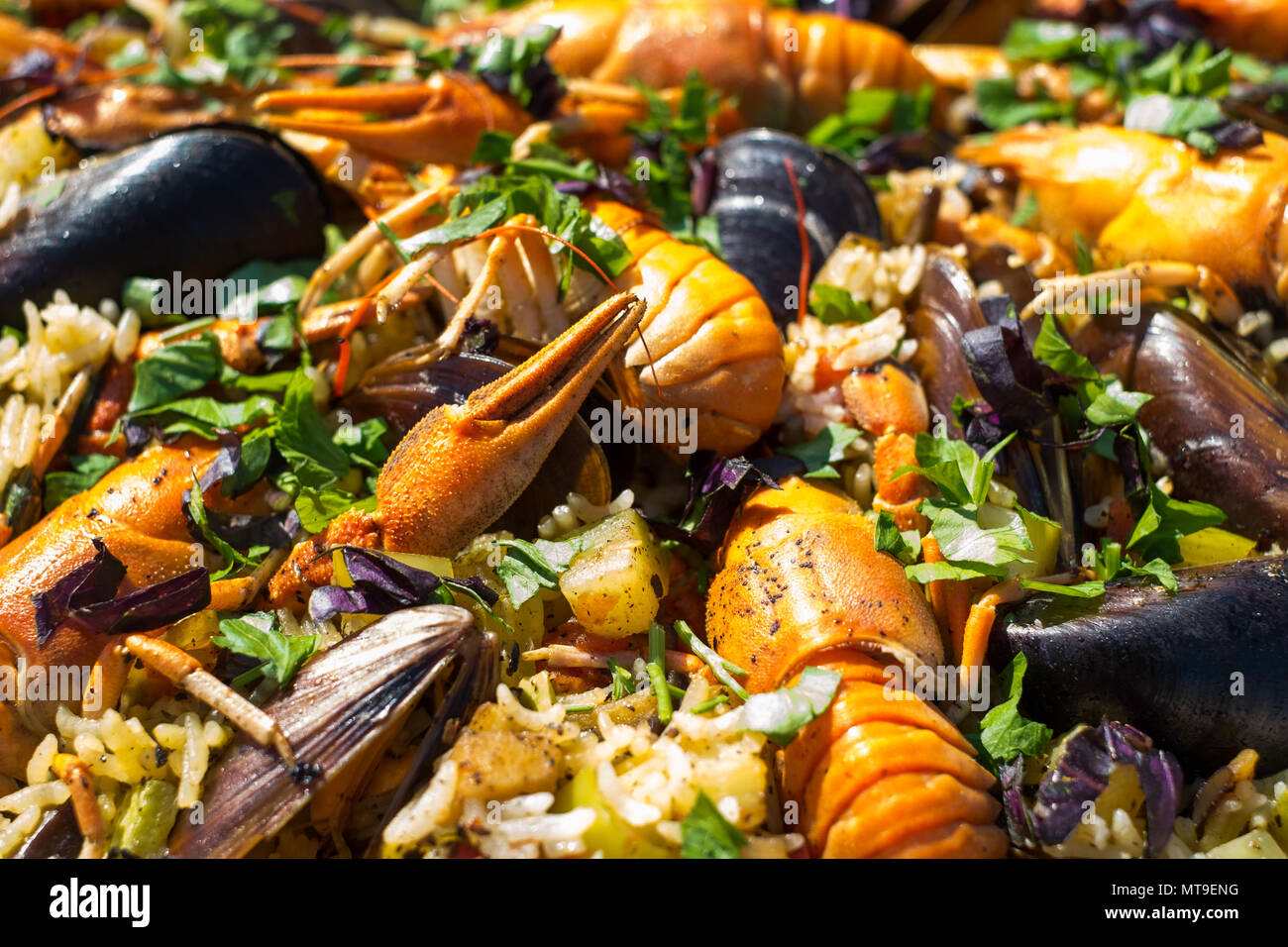 Homemade Spanish Seafood Paella with Prawns Mussels and crayfish - Stock Image