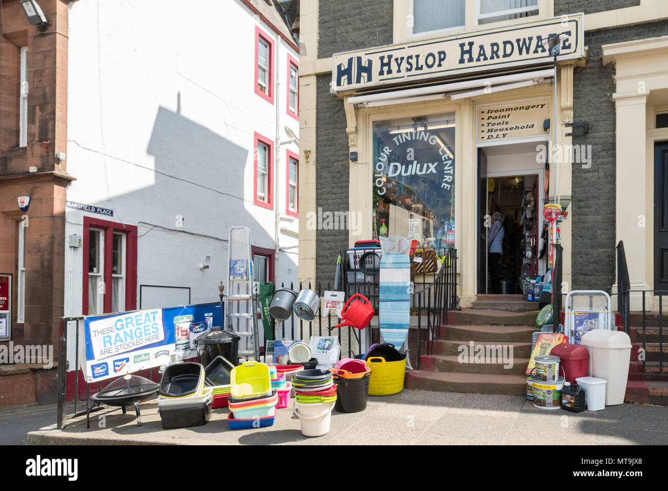 Hardware shop store with display of goods in the street, Moffat, Dumfries and Galloway, Scotland, UK - Stock Image