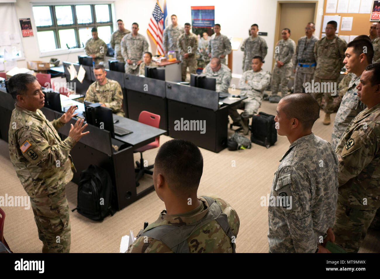 Lt. Col. Shawn Tsuha, Task Force Hawaii commander, addresses his growing team of guardsmen May 16, 2018, at the Joint Operations Center, Hilo, Hawaii. The unit is working alongside with civilian and active duty counterparts under the command of Joint Task Force 5-0 in response to the ongoing volcanic activity on Hawaii Island. (U.S. Air National Guard photo by Senior Airman John Linzmeier) - Stock Image