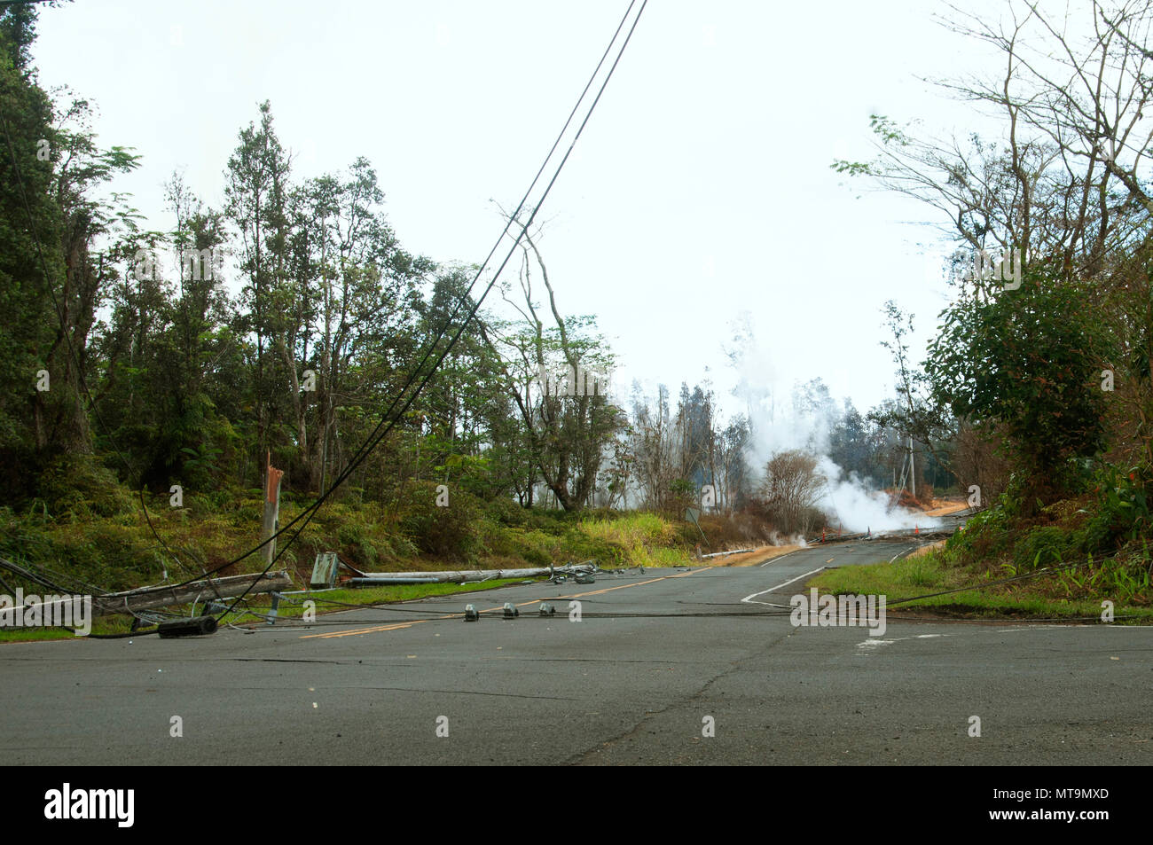 Damaged telephone lines littered residential roads in Leilani estates May 16, 2018, on Hawaii Island. The telephone lines had fallen after they suffered damage during volcanic activity on the island.  (U.S. Air National Guard photo by Tech. Sgt. Alison Bruce-Maldonado) - Stock Image