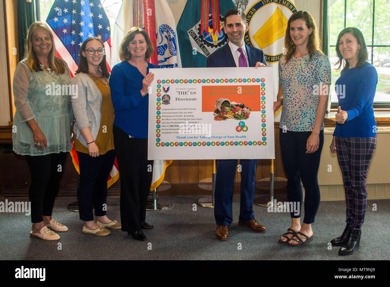 "Employees from ASC G8 (Resource Management) and Matt Sannito, ASC's executive director for Support Operations, pose with the ""Bragging Rights Award"" presented to G8 for having the most participants in the Fit Food Challenge.  The initiative wrapped up on May 14 with a ceremony honoring the 218 employees from ASC and other organizations on Rock Island Arsenal who completed the challenge, sponsored by ASC's Wellness Division. (Photo by Linda Lambiotte, ASC Public Affairs) - Stock Image"