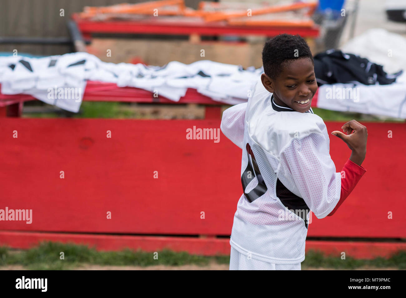 a7822660d593 A member of the Baltimore Youth Lacrosse League looks at his new jersey  with pride April 15