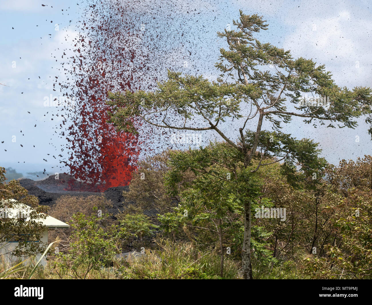 A 17th lava fissure erupts hundreds of feet in the air during a volcano outbreak May 18, 2018, Pahoa, Hawaii. In response to the ongoing outbreak, more than 100 members of the Hawaii National Guard have been called upon to assist Hawaii County agencies as part of an operation called Task Force Hawaii. (U.S. Air National Guard photo by Senior Airman John Linzmeier) - Stock Image