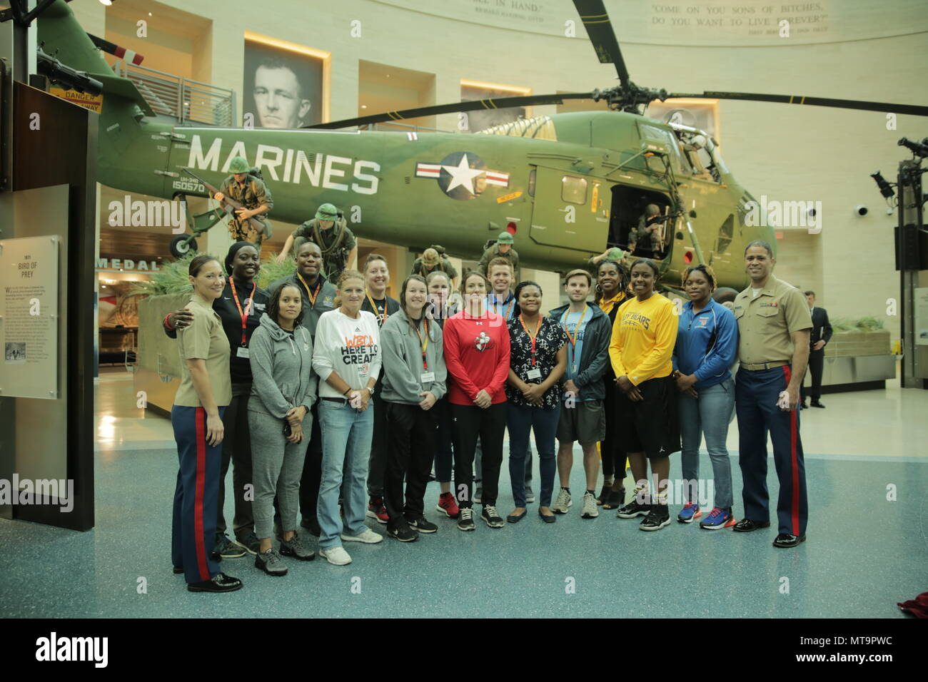 Members of the Women's Basketball Coaches Association (WBCA) and Marines pose for a group photo during a Marine Corps Recruiting Command's 2018 Coaches Workshop in Triangle, Virginia, May 19. The Coaches Workshop educates approximately 50 collegiate coaches from across the nation about essential Marine Corps leadership skills and programs that they can share with their student athletes based on first-hand experiences. WBCA is an organization that helps grow women's basketball by providing educational programs, network opportunities, news, legislative and rule updates, and acting as the collect - Stock Image