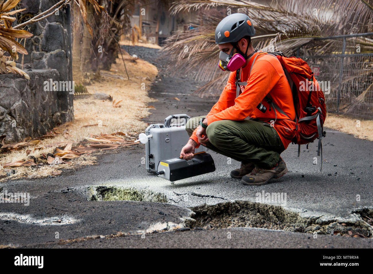 Pāhoa, Hawaii, May 19, 2018 – U.S. Geological Survey (USGS) volunteer Allen Lerner uses a sulfur dioxide (SO2) sensor to test the air quality after the Kīlauea volcanic eruption. The residential area of Leilani Estates has been evacuated due to the high concentration of SO2 emitting from the cracks in the earth that spilled lava into the subdivisions. At the request of the state, FEMA staff are on the ground to support local officials with life-saving emergency protective measures, debris removal, and the repair, replacement, or restoration of disaster-damaged publicly-owned facilities. Photo: - Stock Image