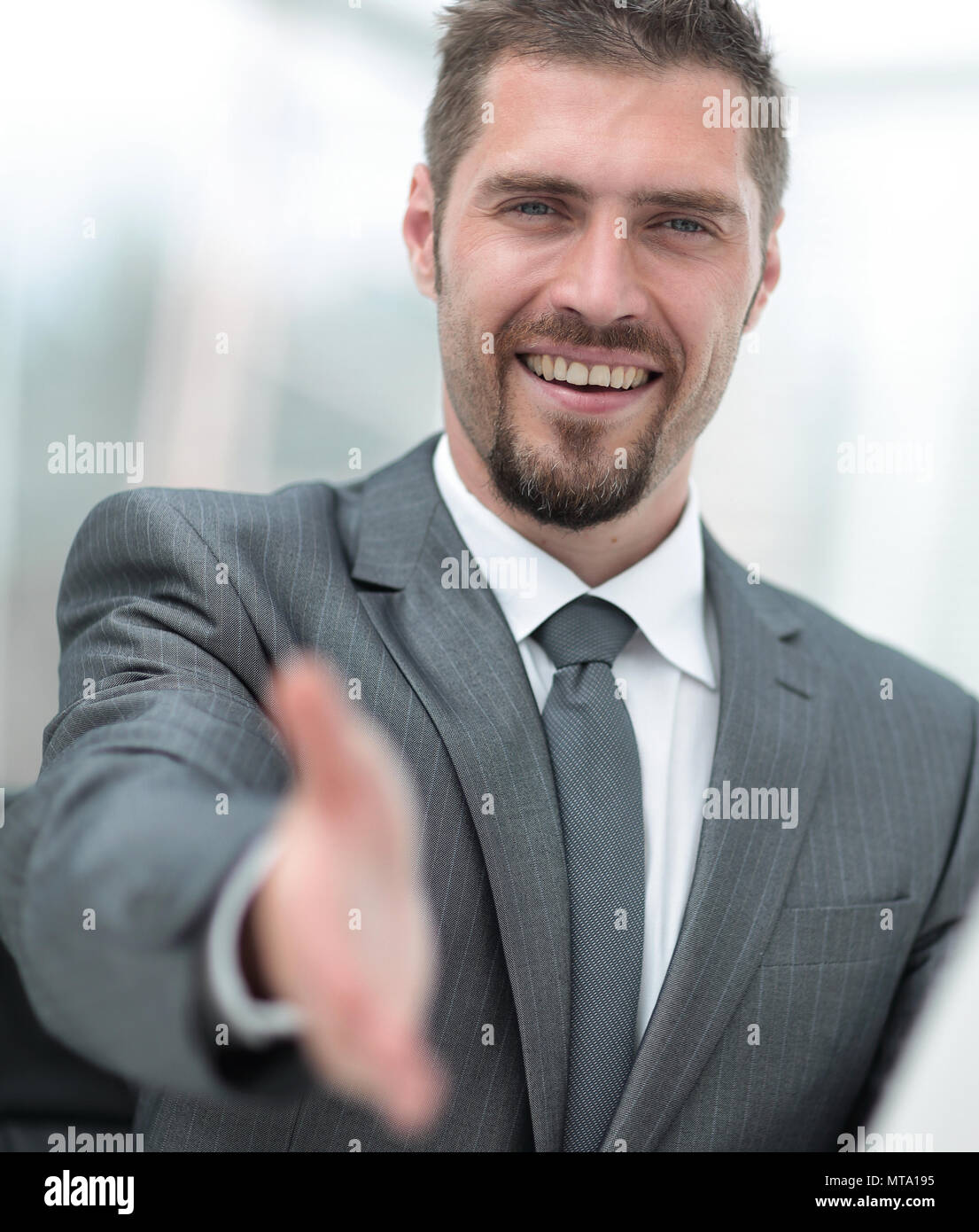 closeup .a successful businessman extends his hand for a handshake, - Stock Image