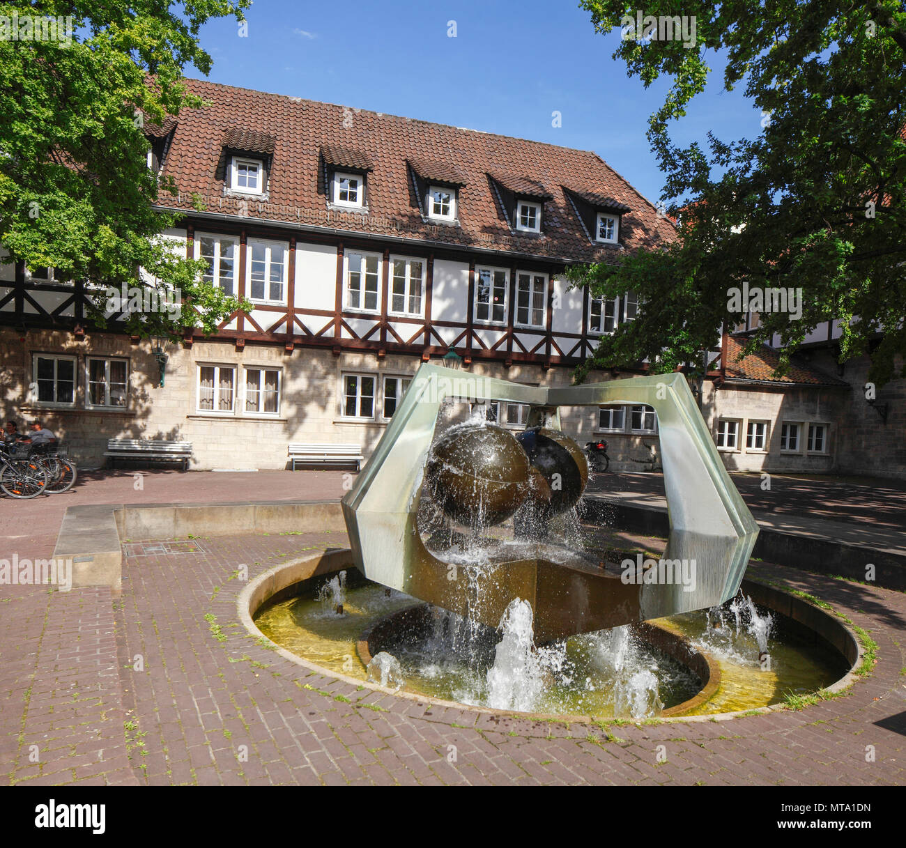 half-timbered house with well at Ballhof Spare, Hannover, Lower-Saxony, Germany, Europe I  Fachwerkhaus am Ballhof mit Brunnen,  Hannover, Niedersachs - Stock Image