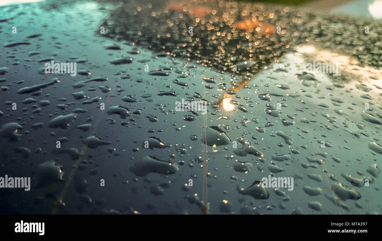 Many of raindrops stuck on the windshield background,Abstract of raindrops on the mirror made with color filters. Stock Photo