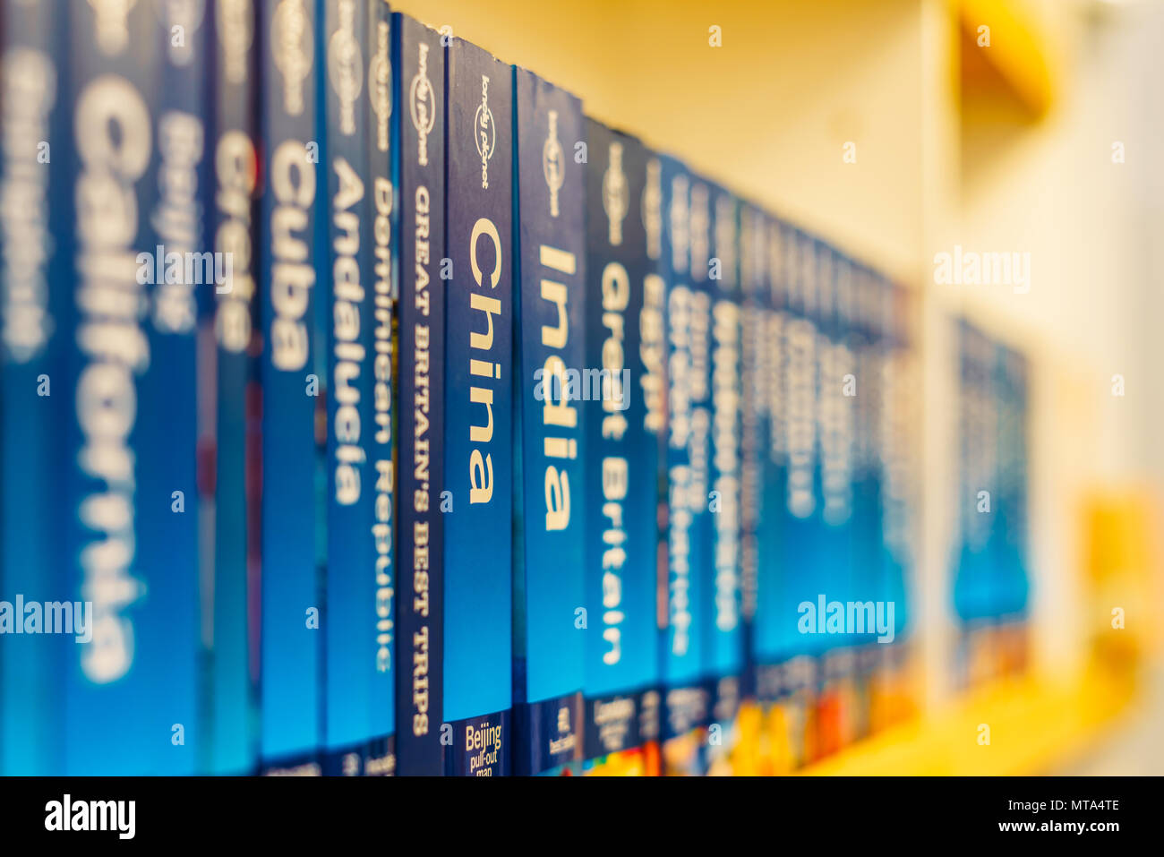 BUCHAREST, ROMANIA - MAY 27, 2018: Cities Of The World And Country Travel Books For Sale On Bookstore Shelf - Stock Image