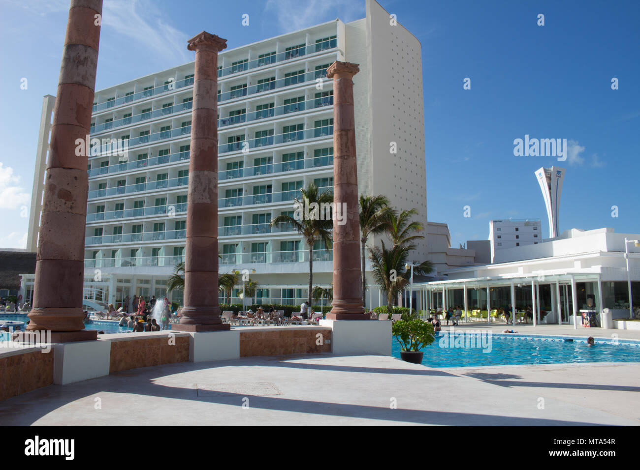 cancun beach hotel with blue sky - Stock Image