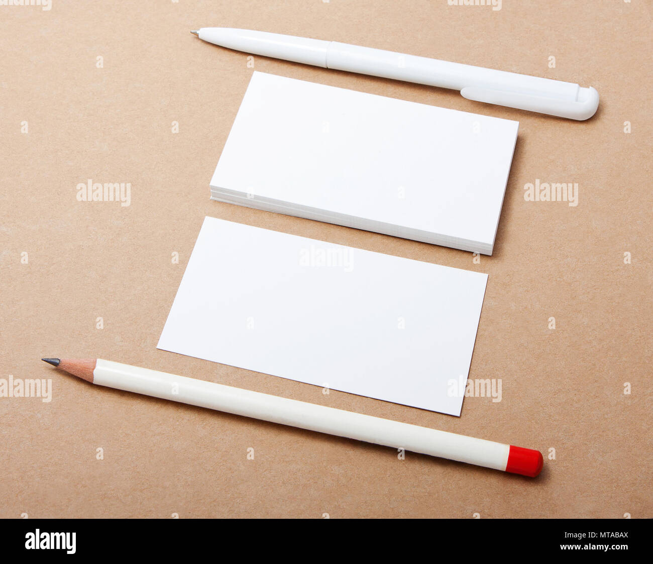 blank business card with pen and pencil on crafts background ...