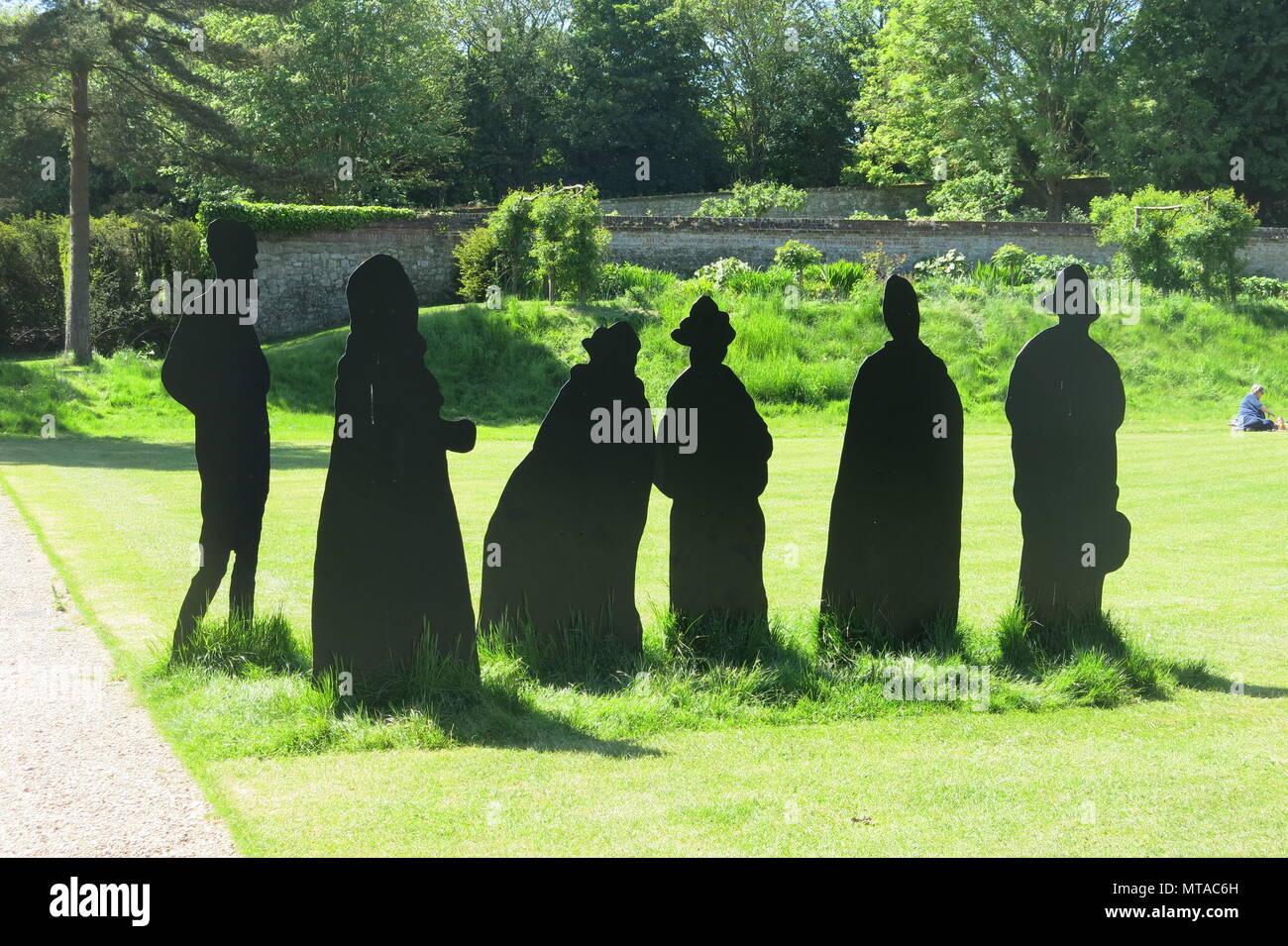 """Six black silhouettes stand on the lawns at Ightham Mote as National Trust fundraising to obtain the painting """"A Game of Bowls"""" by John Singer Sargent. Stock Photo"""