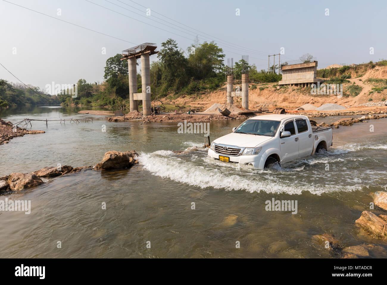 Crossing the Xe Bangfai River, Laos - Stock Image