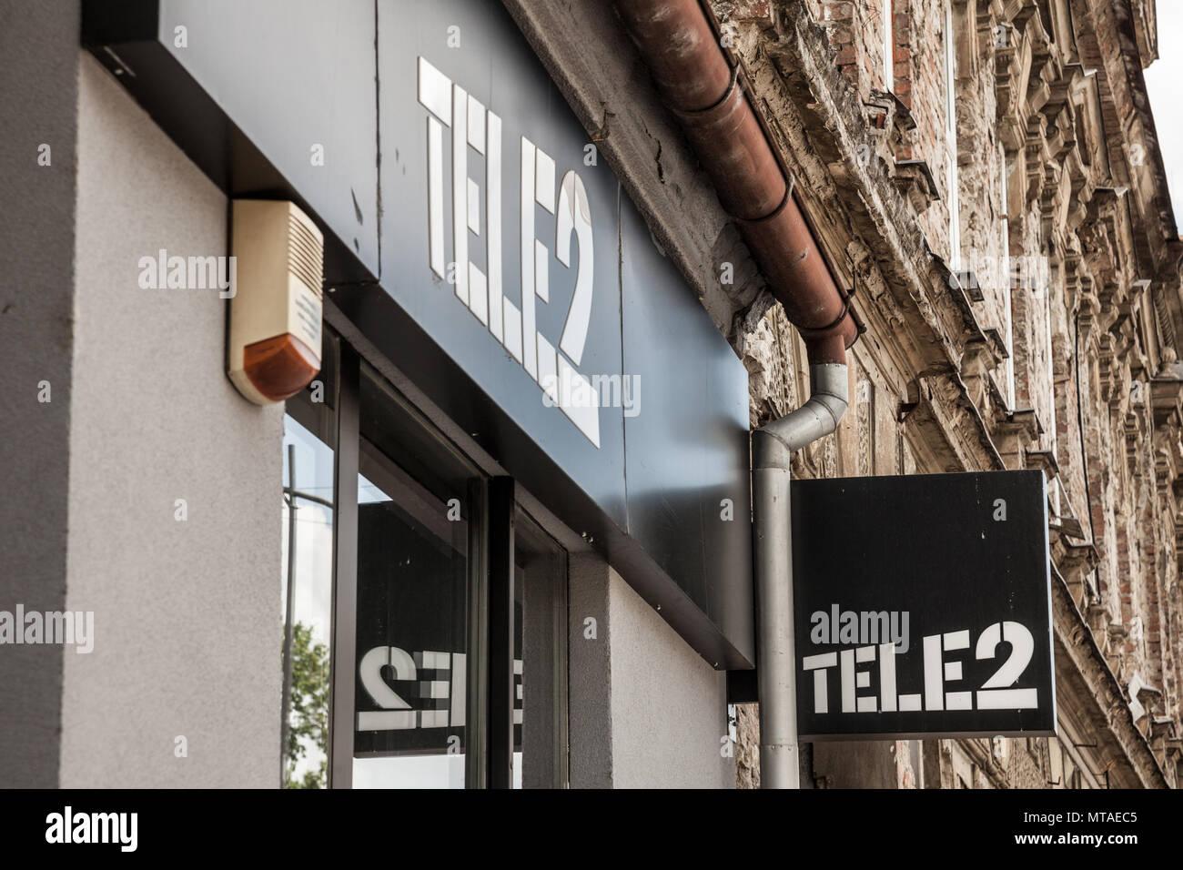 OSIJEK, CROATIA - MAY 12, 2018: Logo of Tele2 sign on their local shop in Osijek. Tele 2 is a European telecommunications operator from Sweden providi - Stock Image