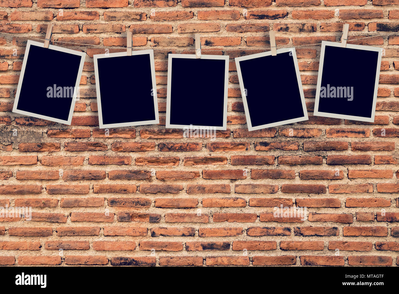 Five Instant Photo Hanging On Old Brick Wall Background And