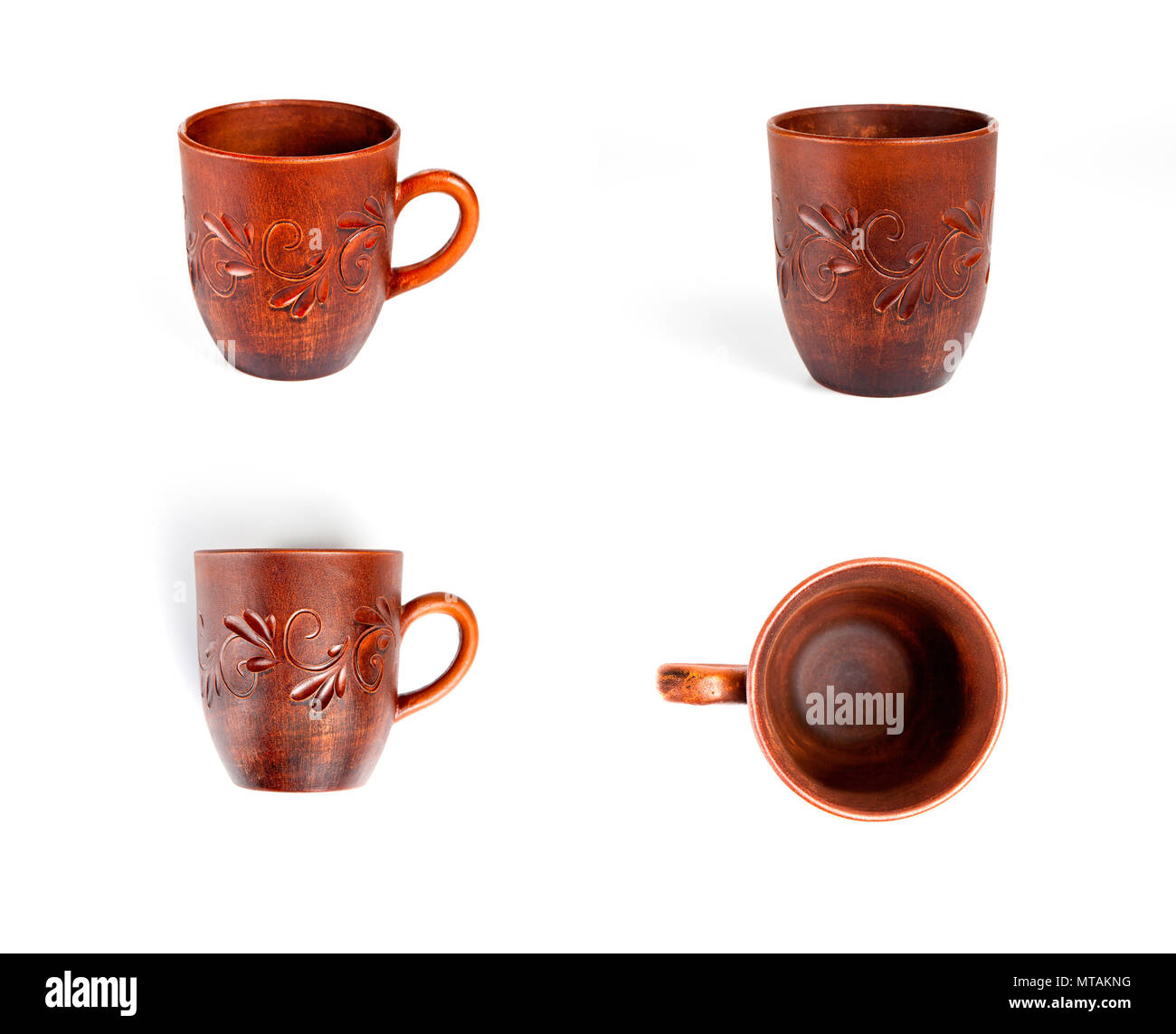 Different point of view of mug with floral pattern on white background - Stock Image