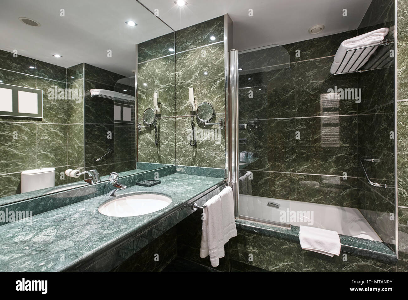Luxury bathroom in green marble decoraton hotel home interior horizontal