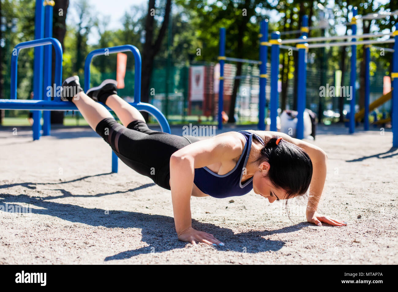 young sportive trainer on sport playground Stock Photo