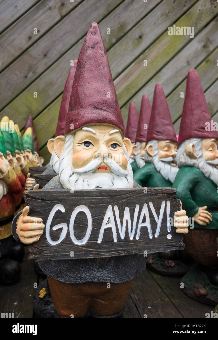 Welcome and Go Away garden gnomes mirror the UK's divided public opinion relating to Brexit - Stock Image