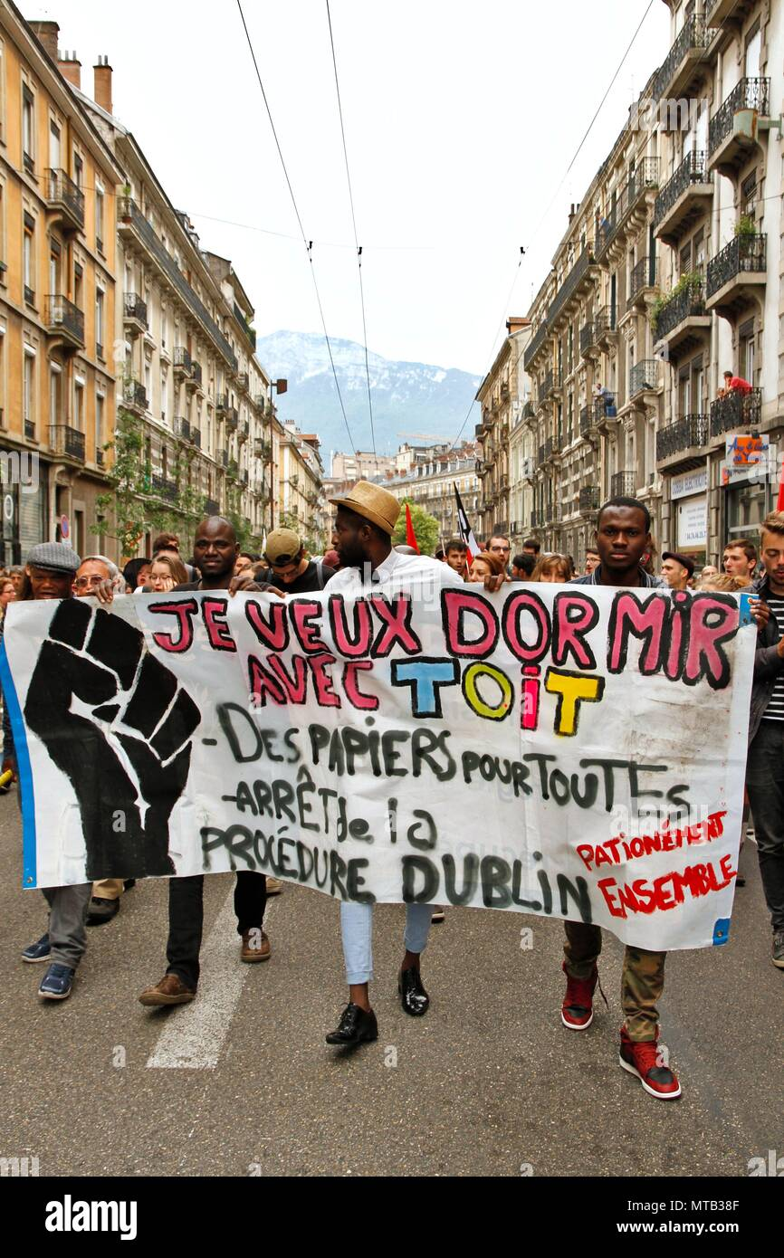Labor and political demonstration of the popular tide initiated by Jean Luc Melenchon and the Insoumis against president Macron. Stock Photo