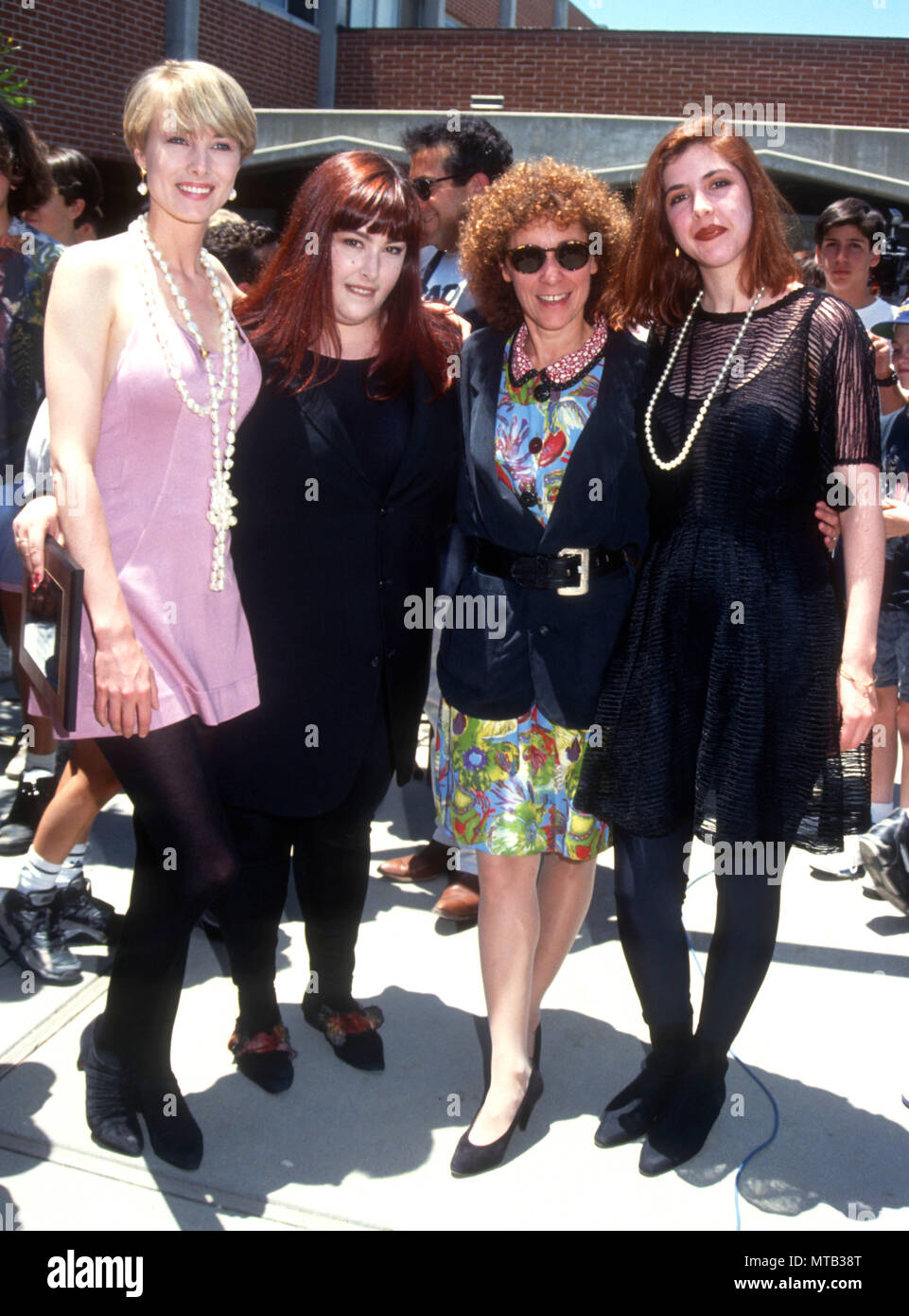 LOS ANGELES, CA - JUNE 3: (L-R) Singers Chynna Phillips. Carnie Wilson, actress Rhea Perlman and Wendy Wilson of Music group Wilson Phillips attend event for National Sober Driving Campaign on June 3, 1991 in Los Angeles, California. Photo by Barry King/Alamy Stock Photo - Stock Image