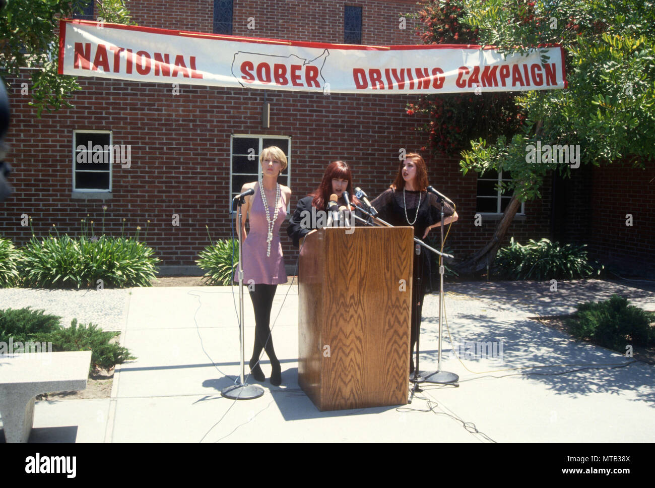LOS ANGELES, CA - JUNE 3: (L-R) Singers Chynna Phillips. Carnie Wilson and Wendy Wilson of Music group Wilson Phillips attend event for National Sober Driving Campaign on June 3, 1991 in Los Angeles, California. Photo by Barry King/Alamy Stock Photo - Stock Image