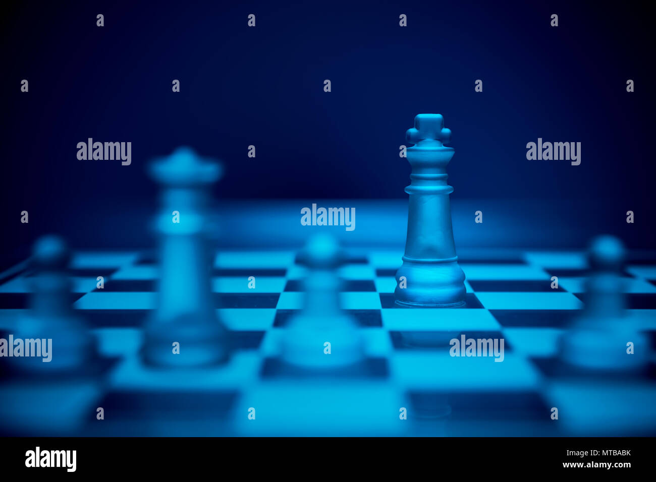 Chess game. King outmaneuvered and stalemate by the queen and pawns. - Stock Image