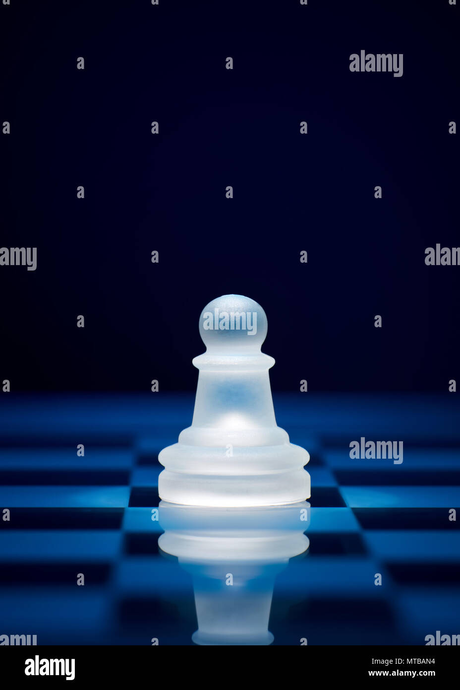 Chess game pieces. The pawn on the chessboard. Stock Photo
