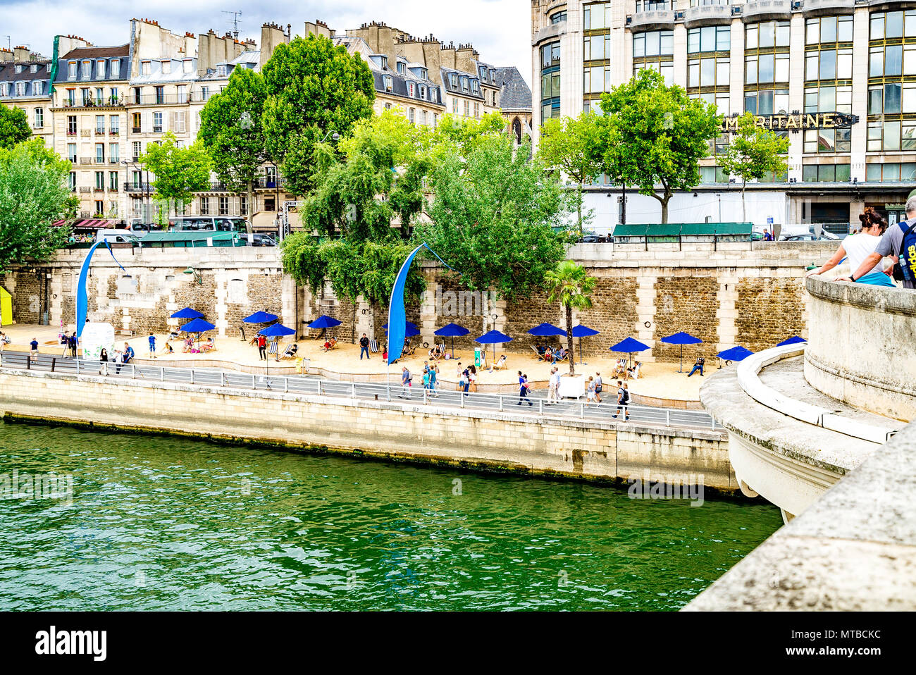 The Paris Plages are temporary artificial beaches each summer along the river Seine in the centre of Paris Stock Photo