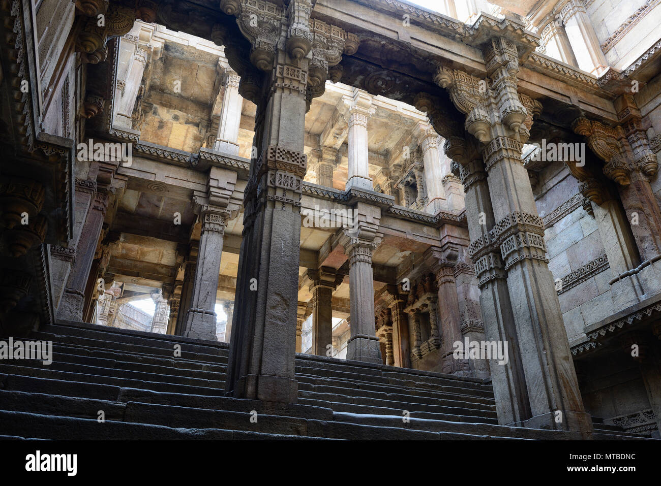 India, Adalaj Stepwell is a Hindu water building in the village of Adalaj, close to Ahmedabad town in the Indian state of Gujarat. - Stock Image