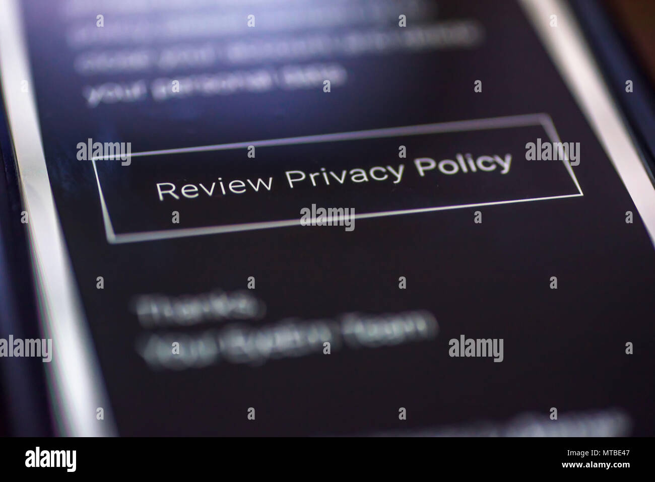 General Data Protection Regulation - GDPR - closeup smartphone message with button Review Privacy Policy. - Stock Image