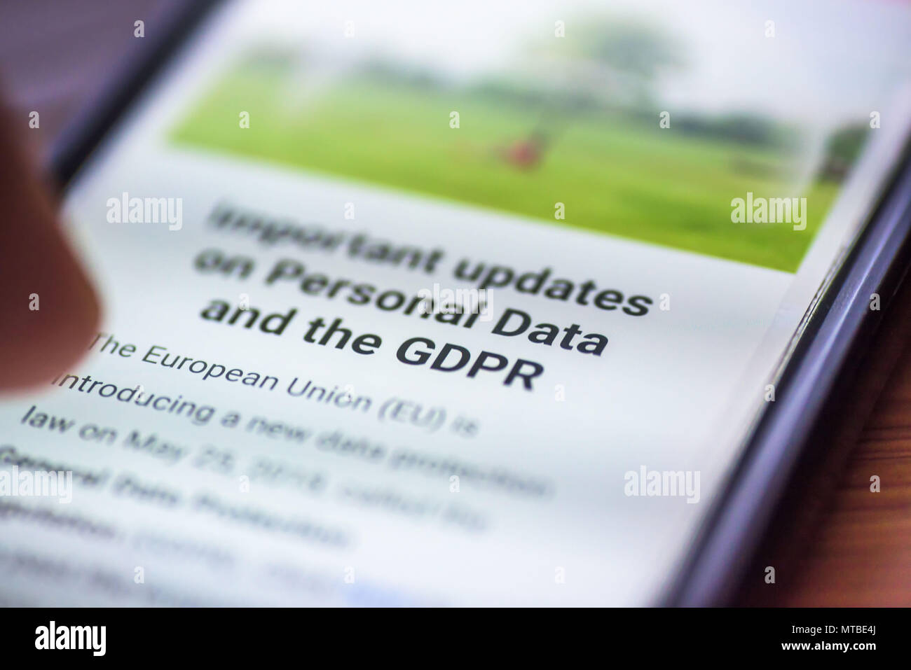 General Data Protection Regulation - closeup human finger pointing to smartphone screen message with text GDPR. - Stock Image