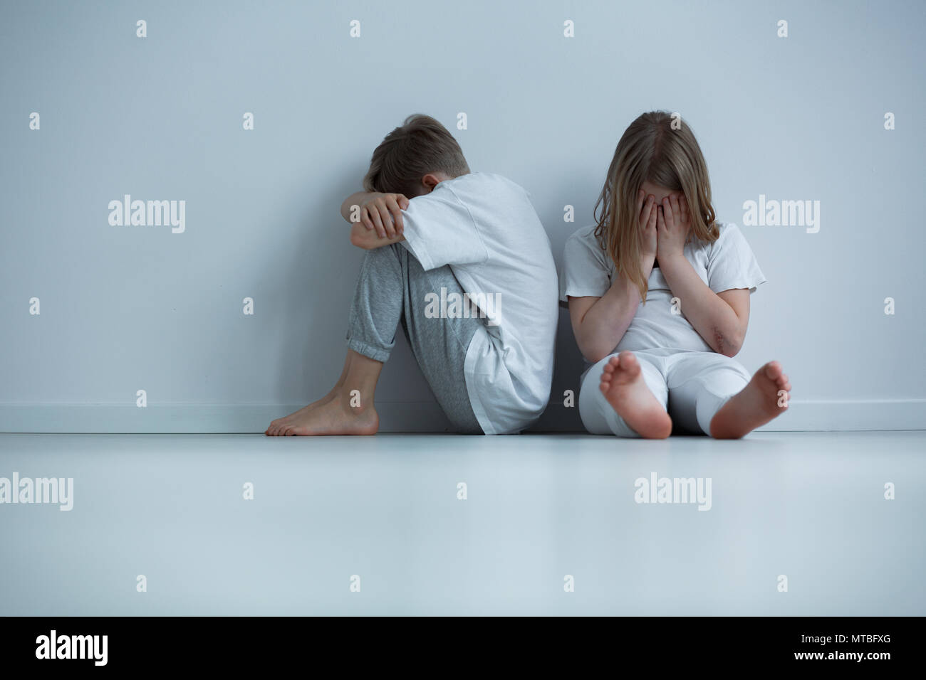 Children living in constant fear - conceptual photo - Stock Image
