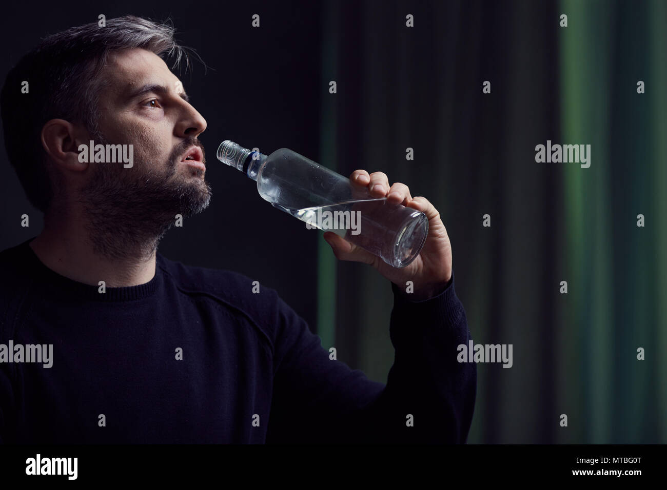 Broken and lonely alcoholic man with depression - Stock Image