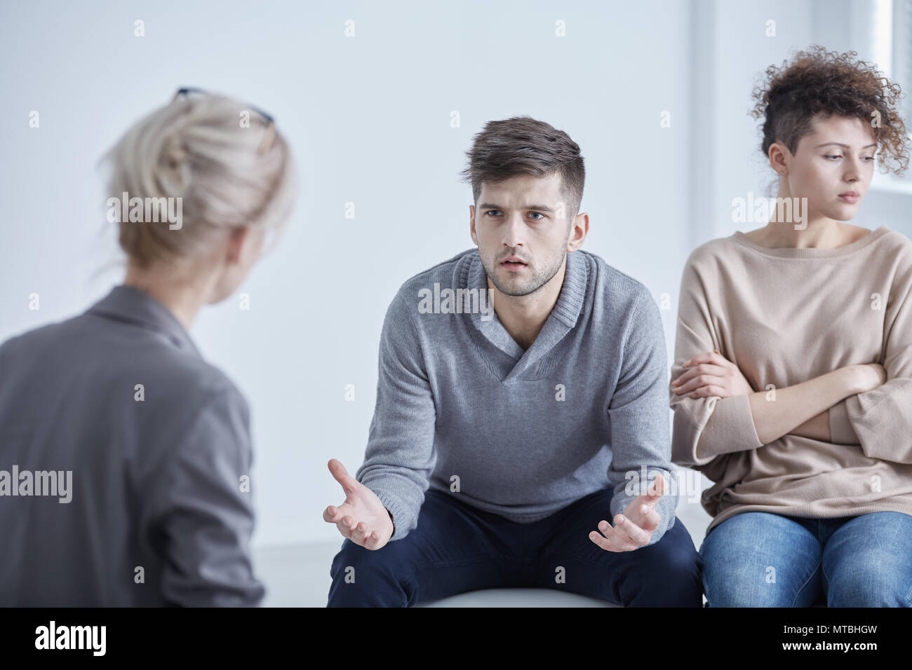Man and woman during therapy for married couples - Stock Image