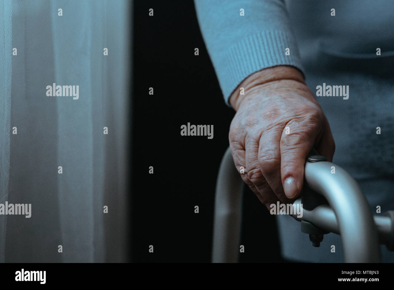 Disableed person with walking frame, close up - Stock Image