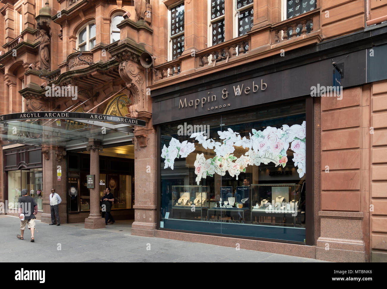 Mappin and Webb, an upmarket jeweller's at the entrance of the Argyle Arcade in Buchanan Street, Glasgow, with Omega at the other side of the entrance - Stock Image