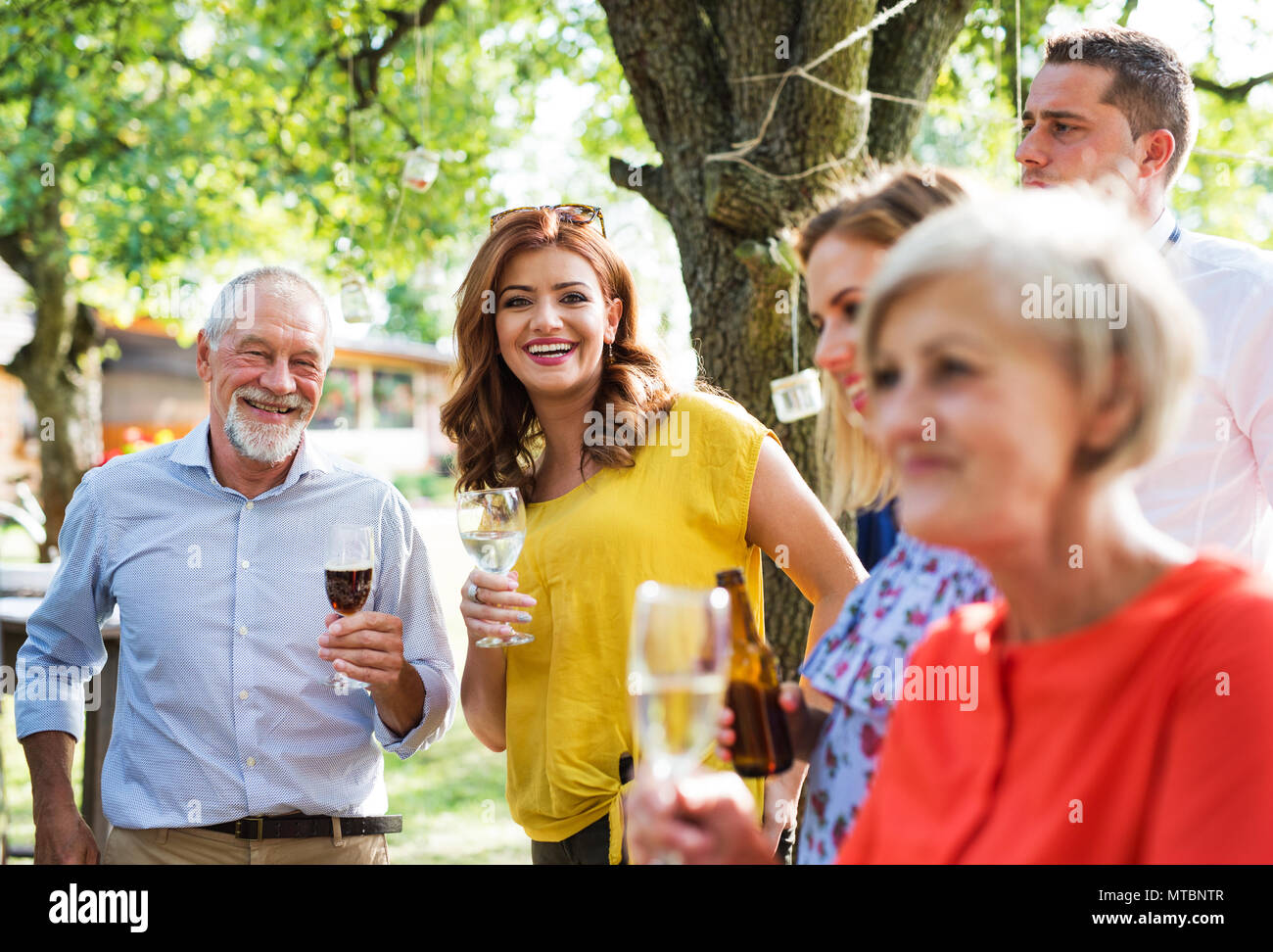 Family celebration or a garden party outside in the backyard. - Stock Image