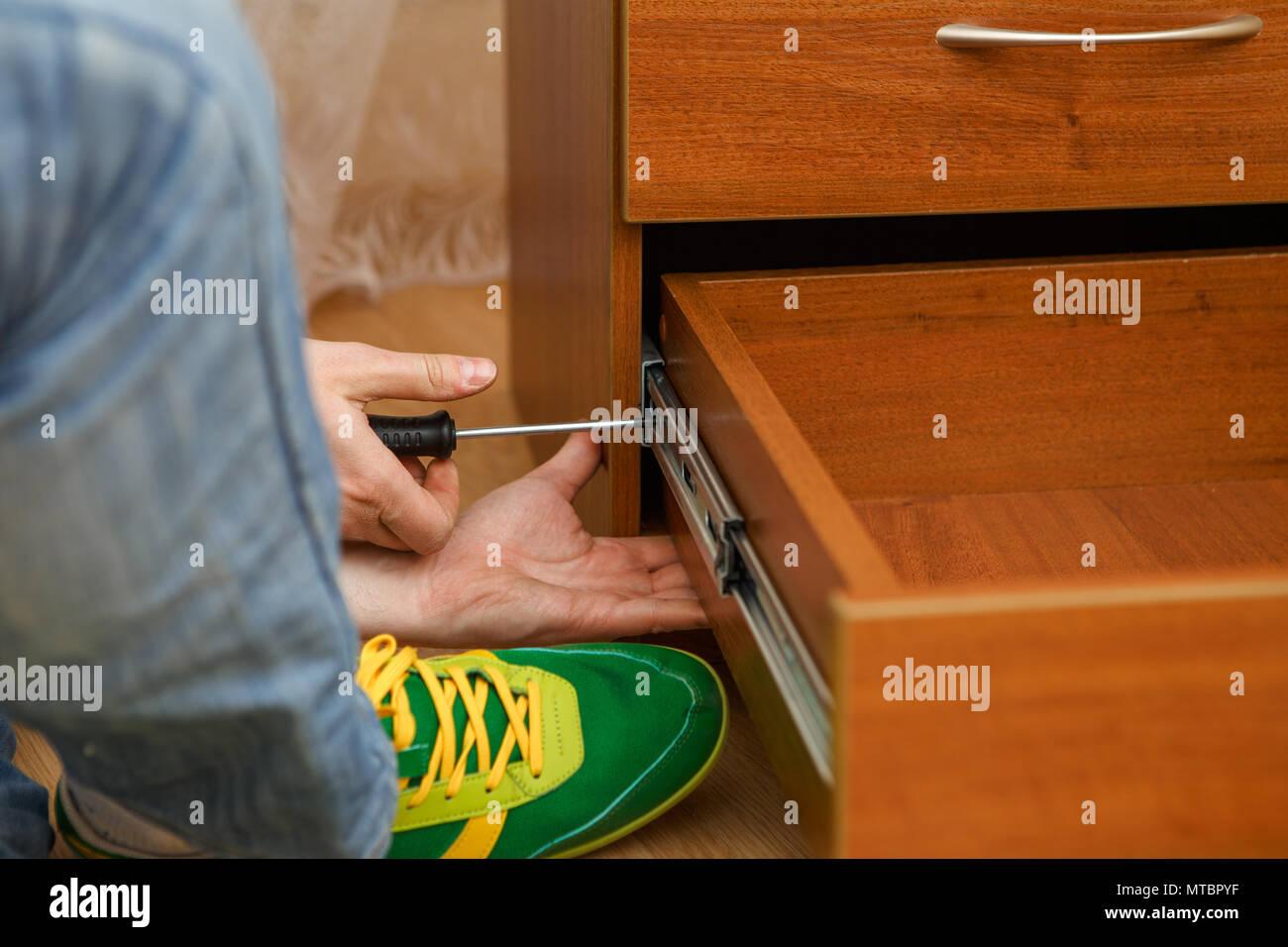 Photo of man picking furniture - Stock Image