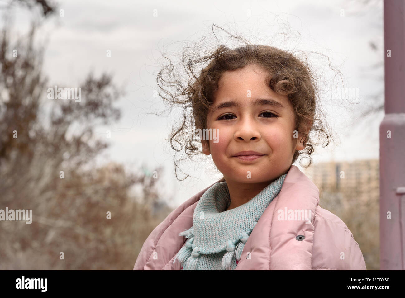 Tabriz, East Azerbaijan province, Iran - March 15, 2018: Iranian girl on the city street in park in spring - Stock Image