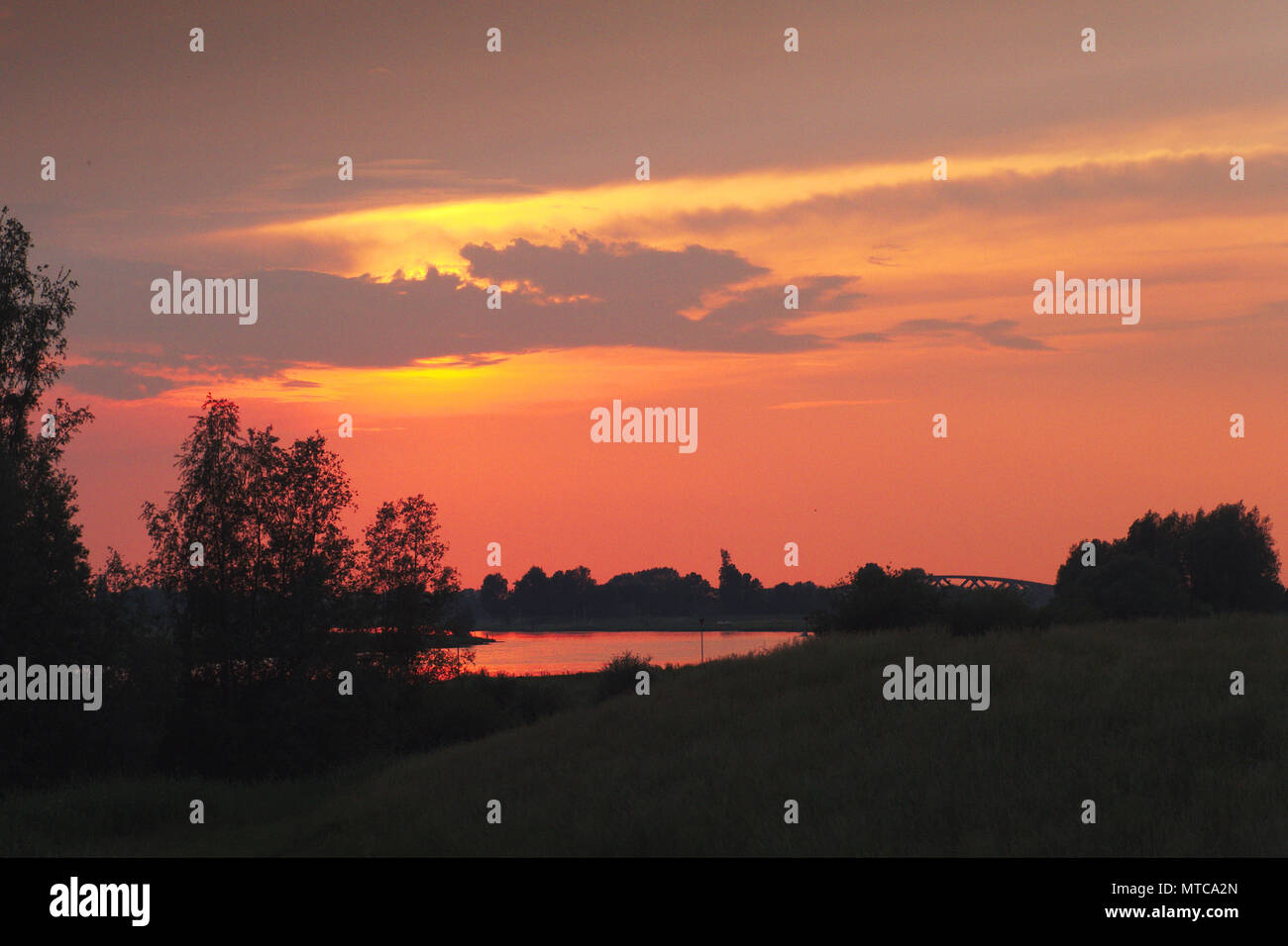 Sunset over the IJssel river near Zwolle Stock Photo