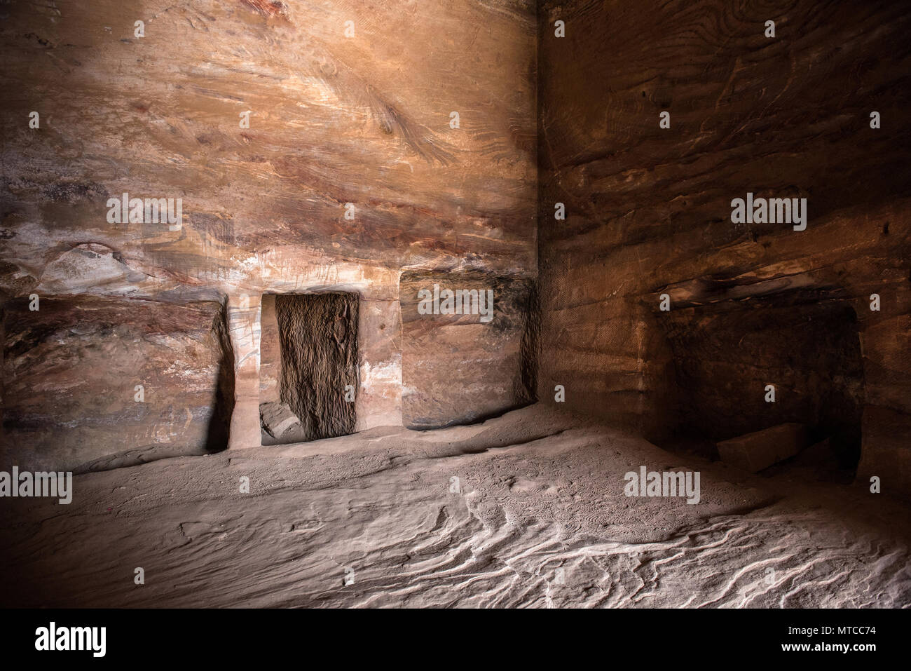 Inside a royal tomb in Petra, Jordan. Underground ancient rock carving, cave used as burial place - Stock Image