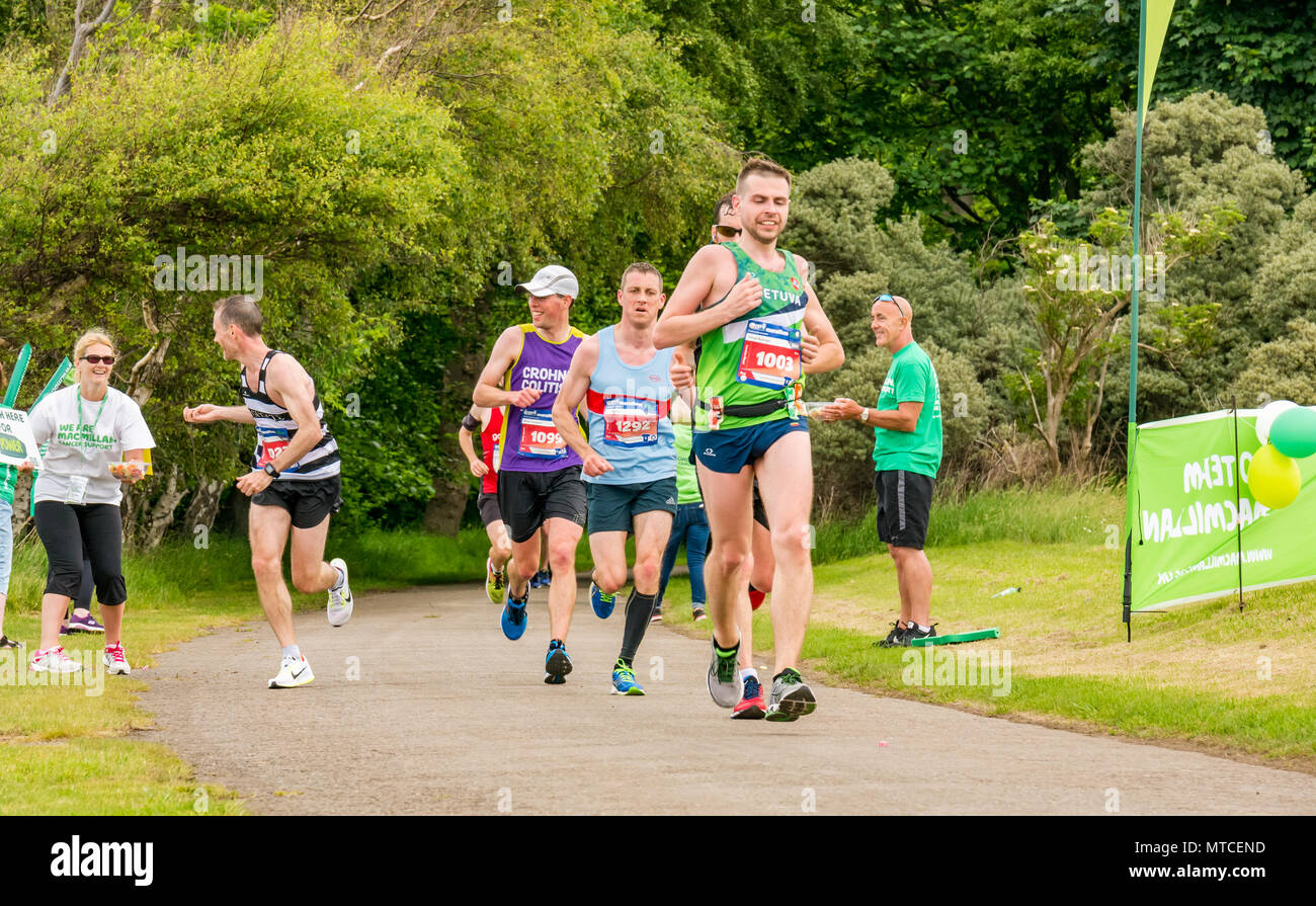 Gosford Estate, East Lothian, Scotland, UK. 28th May 2017. Marathon runners in Edinburgh Marathon with runner offered sweet at Macmillan Cancer stand - Stock Image