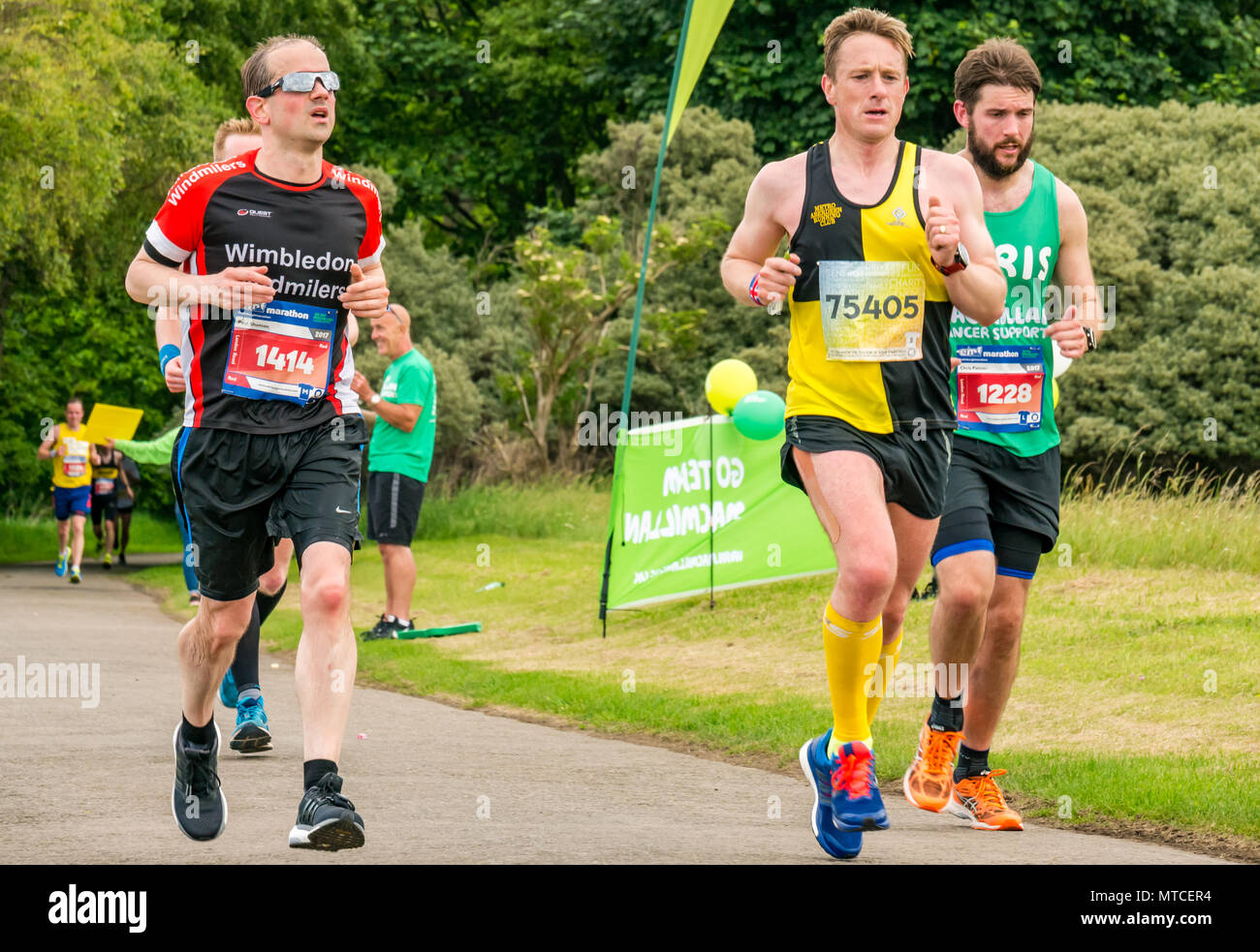Gosford Estate, East Lothian, Scotland, UK. 28th May 2017. Tired male marathon runners in Edinburgh Marathon at Mile 18 - Stock Image